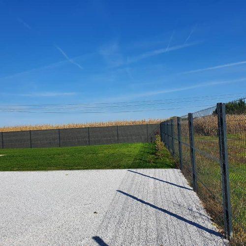 Pose de clôture en panneau rigide à Grenade